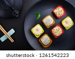 mochi assortment on plate with... | Shutterstock . vector #1261542223