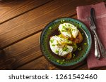 poached eggs on baguette with... | Shutterstock . vector #1261542460