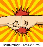 two fists bumping together...   Shutterstock .eps vector #1261544296