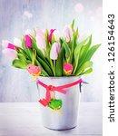 spring tulips in a bucket | Shutterstock . vector #126154643
