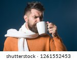 handsome satisfied man with cup ... | Shutterstock . vector #1261552453