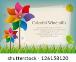 Color Pinwheel On Grass Blue...