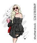 beautiful girl in a stylish... | Shutterstock .eps vector #1261583869