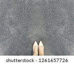 woman foot and legs on concrete ... | Shutterstock . vector #1261657726