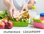 mother preparing school lunch... | Shutterstock . vector #1261690099