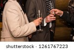 men and woman drinking at... | Shutterstock . vector #1261767223