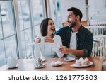couple resting in cafe. couple... | Shutterstock . vector #1261775803