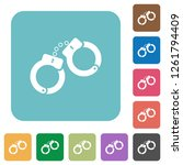 handcuffs white flat icons on...   Shutterstock .eps vector #1261794409