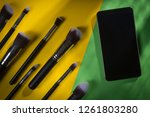 a set of cosmetic brushes on a... | Shutterstock . vector #1261803280