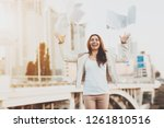 the girl throws paper on the... | Shutterstock . vector #1261810516