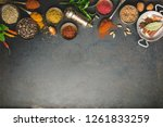 herbs and spices on dark... | Shutterstock . vector #1261833259