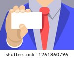 hand with a business card.... | Shutterstock .eps vector #1261860796