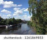 the sunny trent river | Shutterstock . vector #1261869853