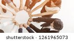 creative team meeting hands... | Shutterstock . vector #1261965073