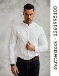 handsome man in white shirt...   Shutterstock . vector #1261995100