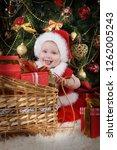 little funny girl in santa... | Shutterstock . vector #1262005243
