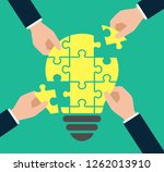 puzzle light bulb and four hands | Shutterstock .eps vector #1262013910