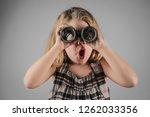 little girl looking into a... | Shutterstock . vector #1262033356