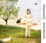 Blonde Girl Reading a Book with Butterflies and Duck - stock photo