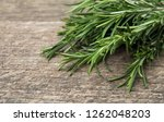 rosemary bound on a wooden board | Shutterstock . vector #1262048203