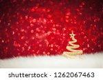 shining christmas tree   golden ... | Shutterstock . vector #1262067463