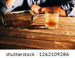 alcoholic addict. man near the... | Shutterstock . vector #1262109286