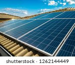 solar panel on a red roof... | Shutterstock . vector #1262144449