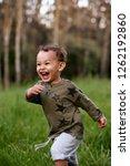 young mixed race boy running... | Shutterstock . vector #1262192860