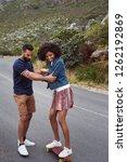 boyfriend teaching girlfriend... | Shutterstock . vector #1262192869
