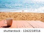 sea and cup of coffee  at...   Shutterstock . vector #1262218516
