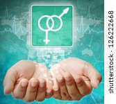 Male and female Symbol on hand ,medical icon - stock photo