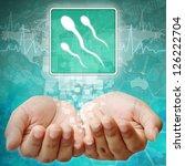 Spermatozoon symbol on hand ,medical icon - stock photo