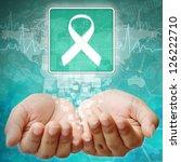 Aids ribbon symbol on hand ,medical background - stock photo