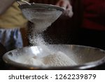 flour sifting while cooking | Shutterstock . vector #1262239879