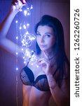 sensual woman in garland near... | Shutterstock . vector #1262260726