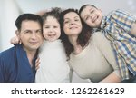 beautiful smiling family... | Shutterstock . vector #1262261629