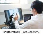 stock exchange trader analyzing ...   Shutterstock . vector #1262266093