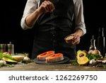 the chef prepares fresh salmon... | Shutterstock . vector #1262269750