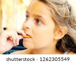little girl eating cookies on a ... | Shutterstock . vector #1262305549
