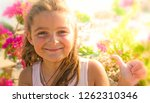 smiling little girl showing... | Shutterstock . vector #1262310346