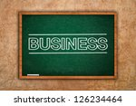 Teaching business concept. Word Business on green chalkboard, business seminar concept. - stock photo