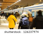 Commuters departing winter train - stock photo
