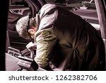 a mechanic work  repairs a... | Shutterstock . vector #1262382706