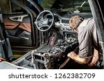 a mechanic repairs a luxury suv ... | Shutterstock . vector #1262382709