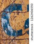 blue letter on rusty metal ...   Shutterstock . vector #1262406550