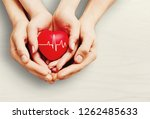 man and woman holding red heart ... | Shutterstock . vector #1262485633