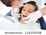Healthy teeth child patient at dentist office dental caries prevention - stock photo