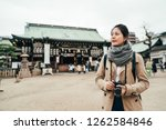 Stock photo young girl lens man standing in the ground of tenmangu temple in osaka japan lady tourist holding 1262584846