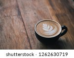 cup of coffee latte with... | Shutterstock . vector #1262630719
