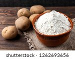 potato starch on dark wooden... | Shutterstock . vector #1262693656